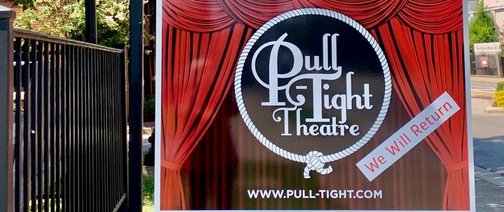 """""""We'll Be Back"""" sign outside Pull-Tight Theatre"""
